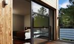 Maison ossature bois Landes : baies vitrées et terrasse